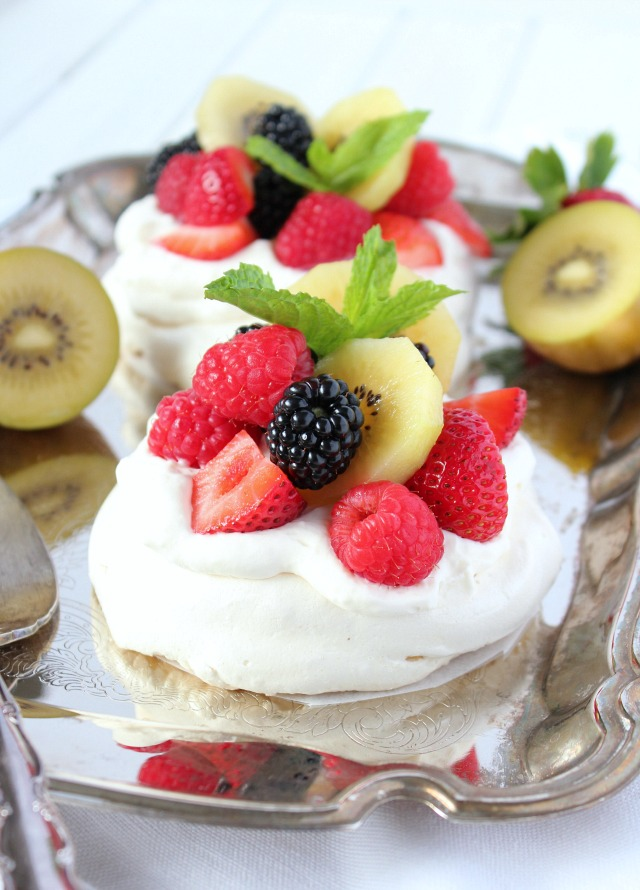 Mini Pavlova with Whipped Cream, Berries and Kiwi on a Silver Platter