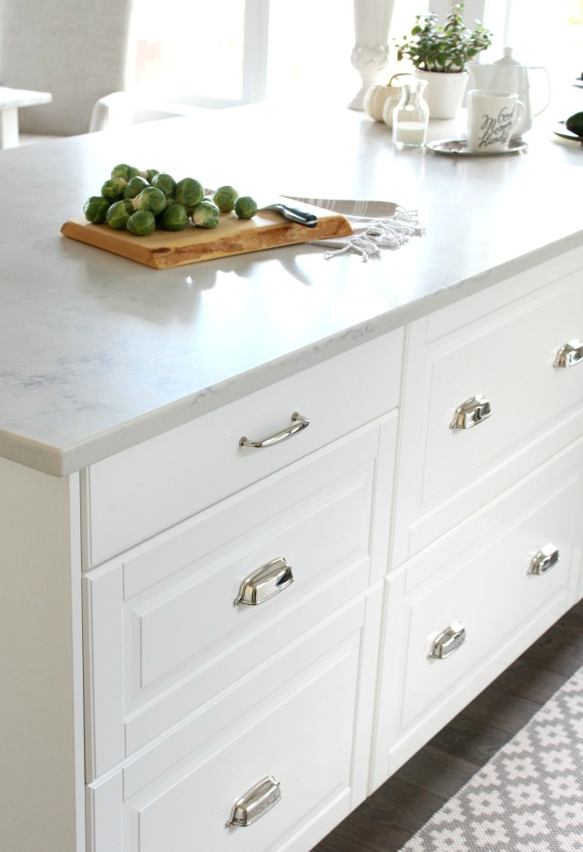 White IKEA Kitchen Island with Drawers and Polished Nickel Hardware