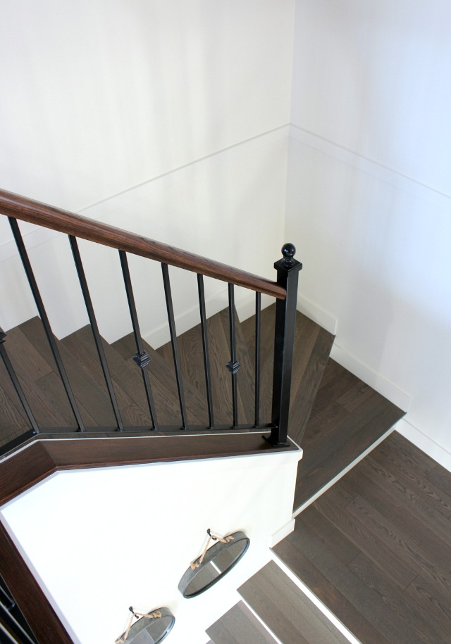 Installing Hardwood Stairs with Iron Railings