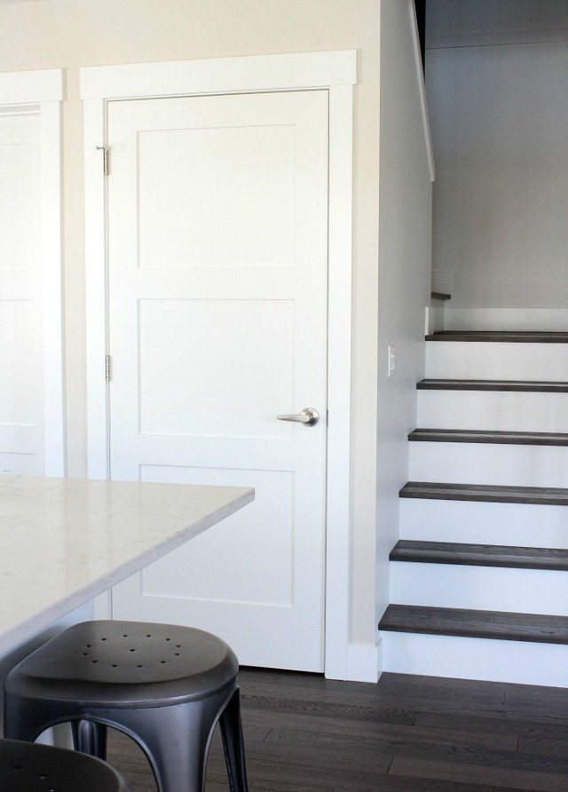 Stairs with White Risers and Dark Treads - Shaker Style White Doors in Kitchen