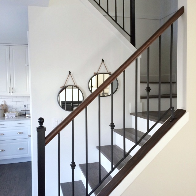 Stairs Makeover - Dark Hardwood Treads with White Risers - Iron Railings