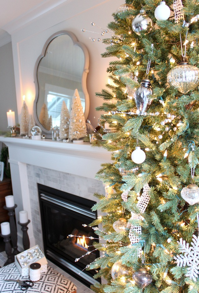Mantel Decorated for Christmas Using Bottle Brush Trees, Greenery, Candles and More!