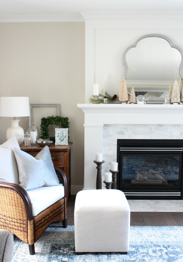White and Marble Fireplace Decorated for the Holidays