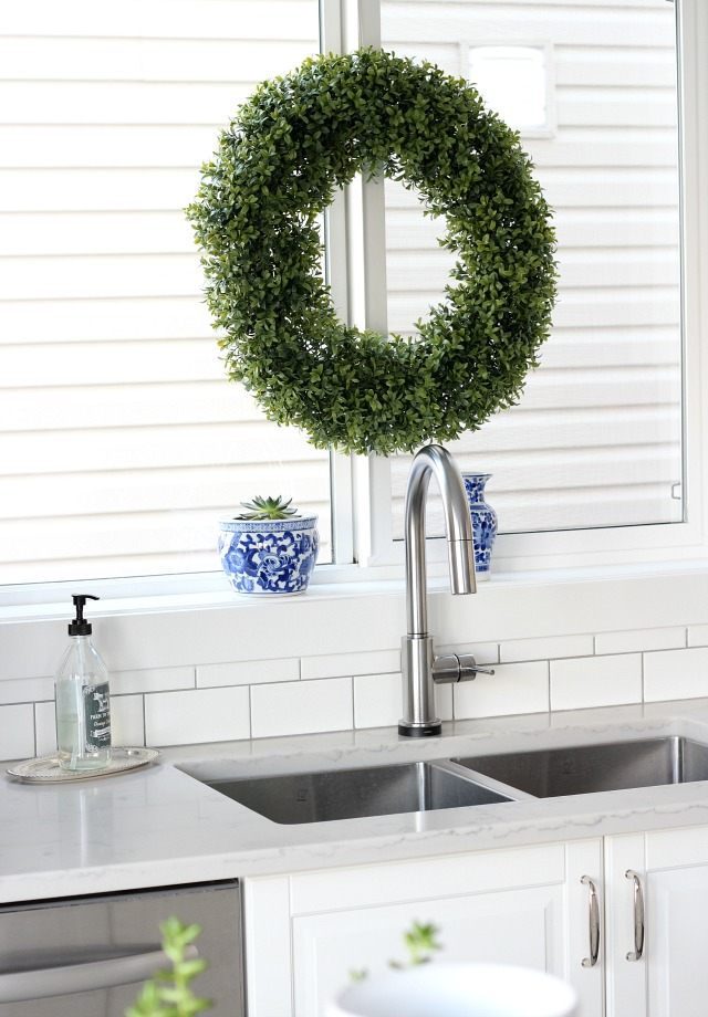 Christmas Kitchen Decor - Boxwood Wreath Hung from the Kitchen Window