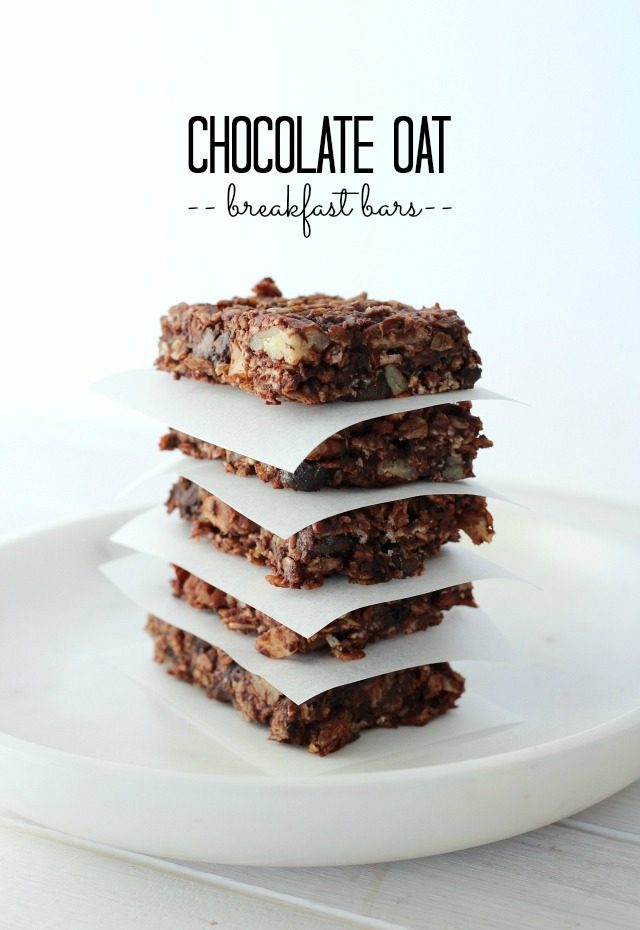 Stack of Gluten Free Chocolate Oat Breakfast Bars on Marble Plate