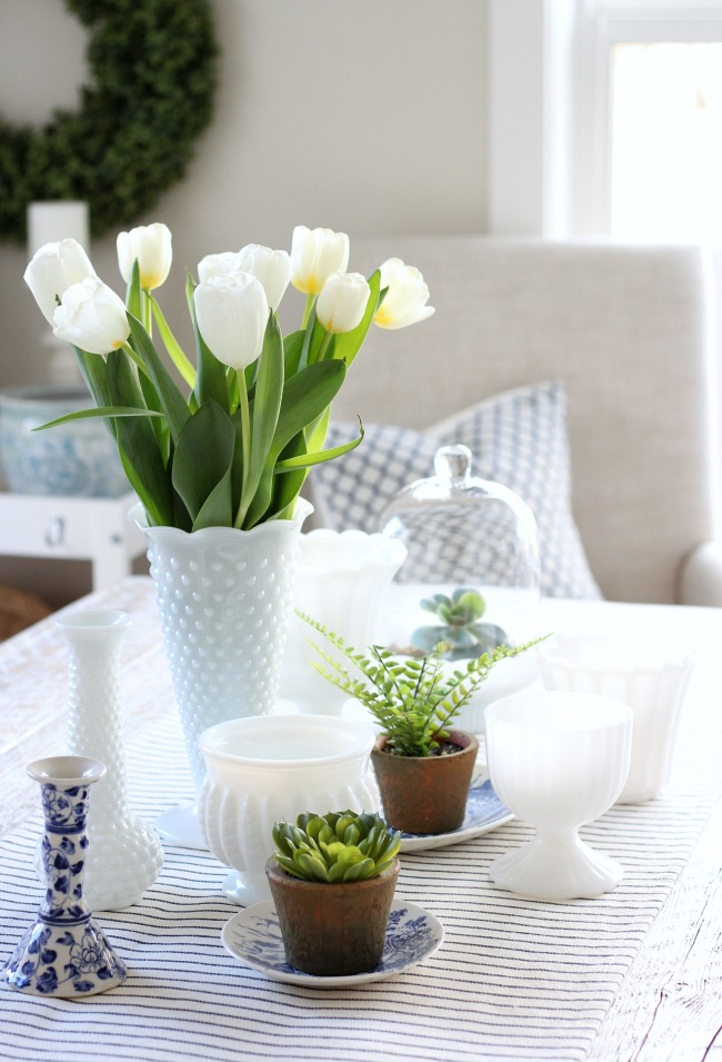 Beautiful Kitchen Decor Ideas for Spring - Milk Glass Centerpiece with Spring Plants