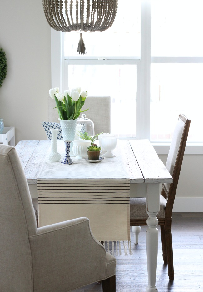 Spring Decorating Ideas for the Kitchen - Whitewashed Reclaimed Wood Dining Table and Beaded Chandelier