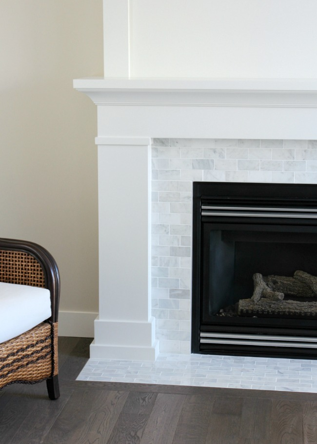 Shaker Style Fireplace with White Painted MDF Mantel and Marble Subway Tile Surround