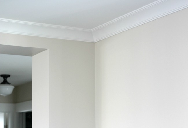 White Crown Moulding in the Living Room with Benjamin Moore Baby Fawn Walls