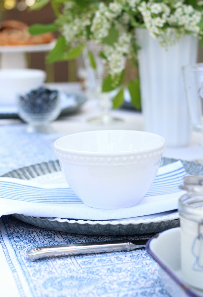 Casual Outdoor Brunch Place Setting in Blue and White - Tips for Hosting a Summer Outdoor Brunch