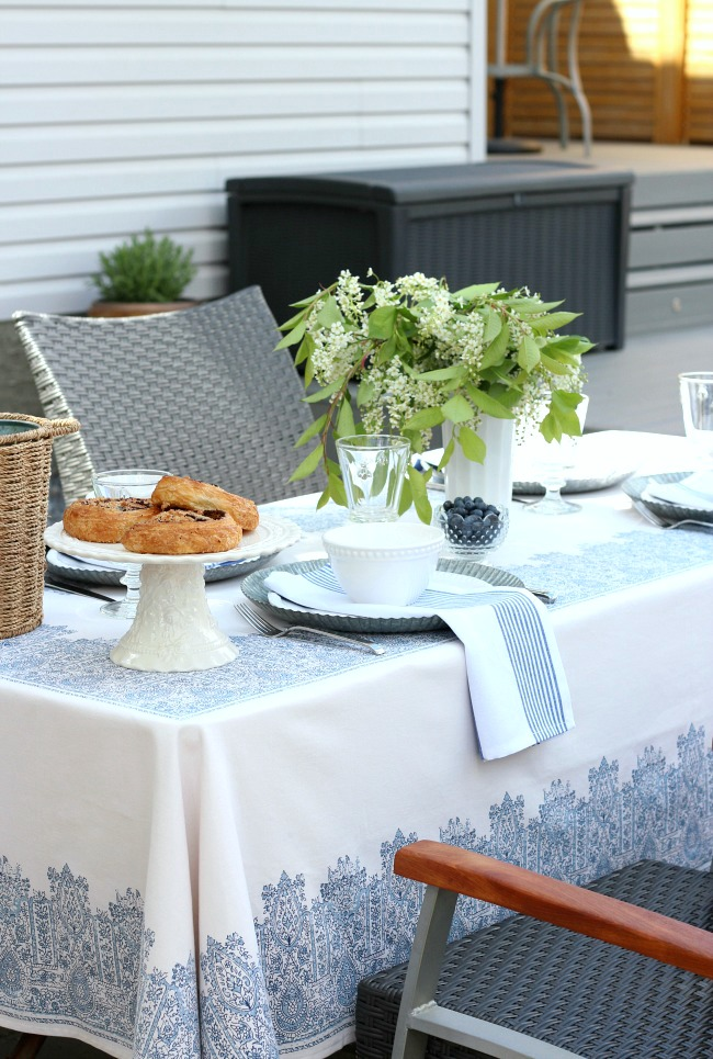 Blue and White Outdoor Table Setting with Tree Blossom Arrangement in Milk Glass Vase - Satori Design for Living