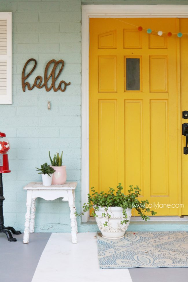 Mustard Front Door Paint with Colorful Front Porch Decor by Lolly Jane - Jackson Square by Valspar
