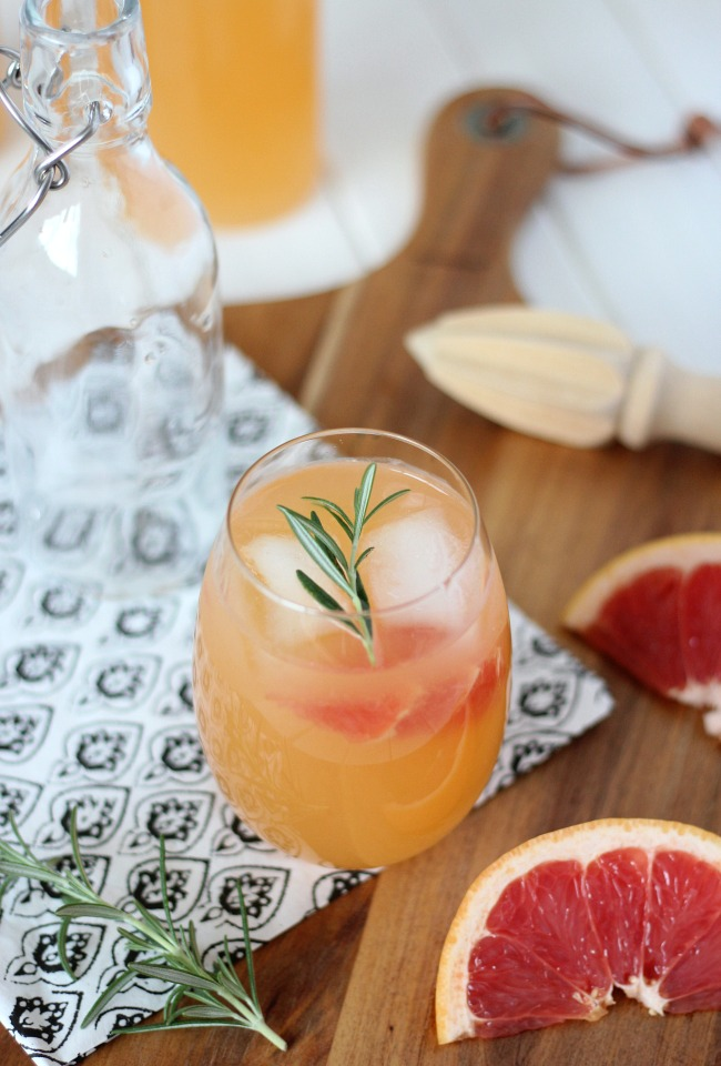 Rosemary and Grapefruit Vodka Spritzer in Cocktail Glass with Icea