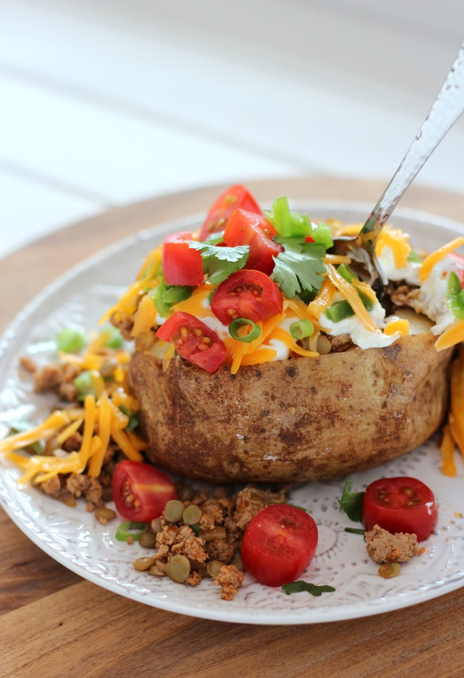 Baked Potato Topped with Ground Turkey, Lentils, Tomatoes, Cheese and More!