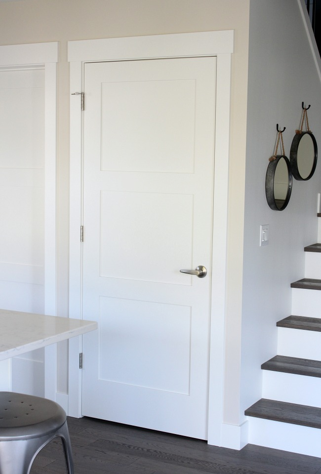 White Shaker Style Trim Work Around Simple 3-Panel Doors