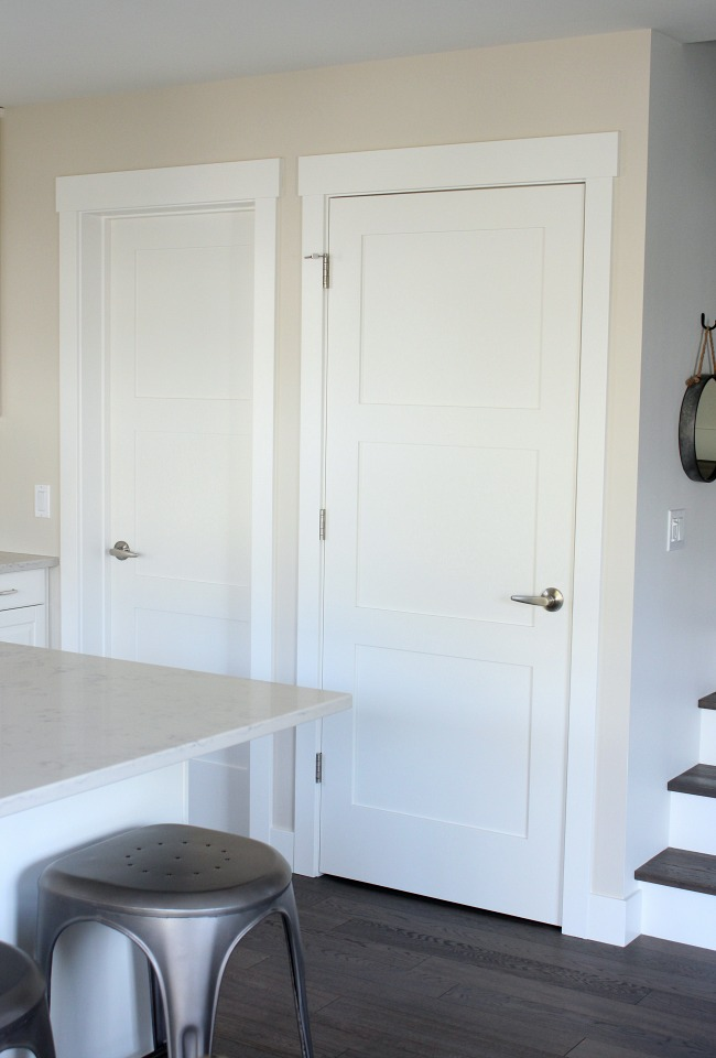 White 3 Panel Shaker Style Doors in the Kitchen with White Oak Floors