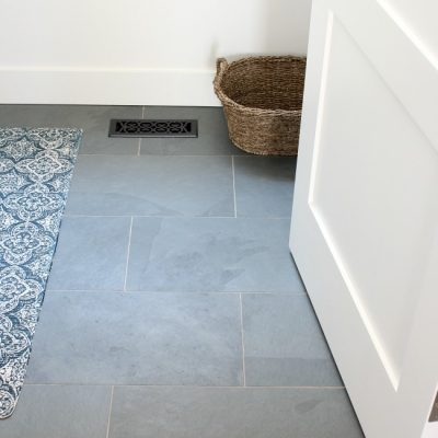 White Shaker Style Baseboards and 3-Panel Door in the Laundry Room - Brazilian Slate Floor - Satori Design for Living
