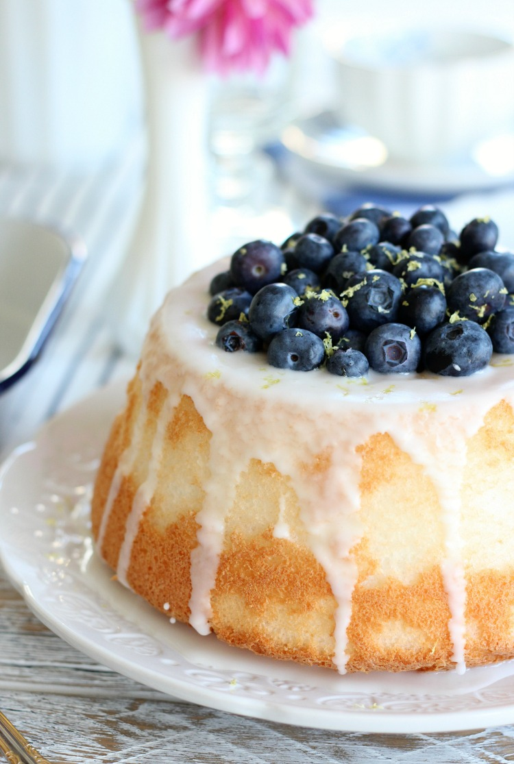 Angel Food Cake Stuffed with Lemon Curd and Fresh Blueberries on Pretty White Plate