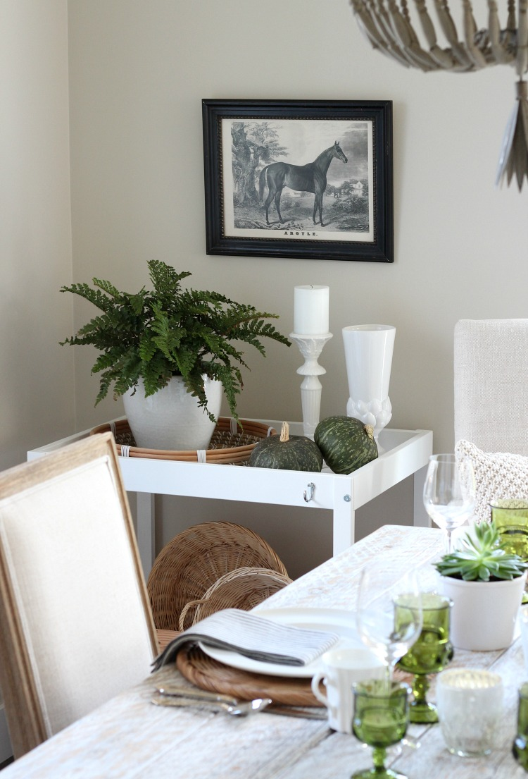 Eclectic Fall Tablescape with Green, Gold and White Decor - Styled White Cart with Potted Fern and Equestrian Art - Satori Design for Living
