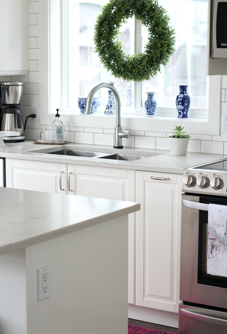 Christmas Home Tour - White Kitchen with Boxwood Wreath Hung in the Window - Satori Design for Living