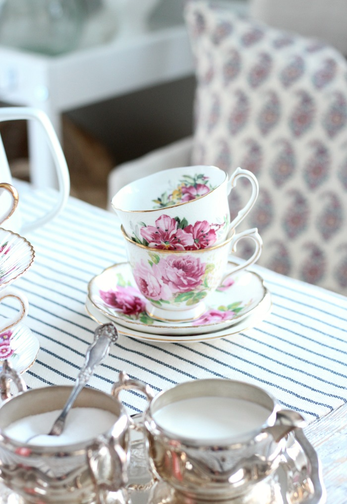 Decorating with Thrift Store Finds - Table Setting with Vintage Pink Floral Tea Cups and Silver Cream and Sugar Set #thrifting #thriftstoredecor