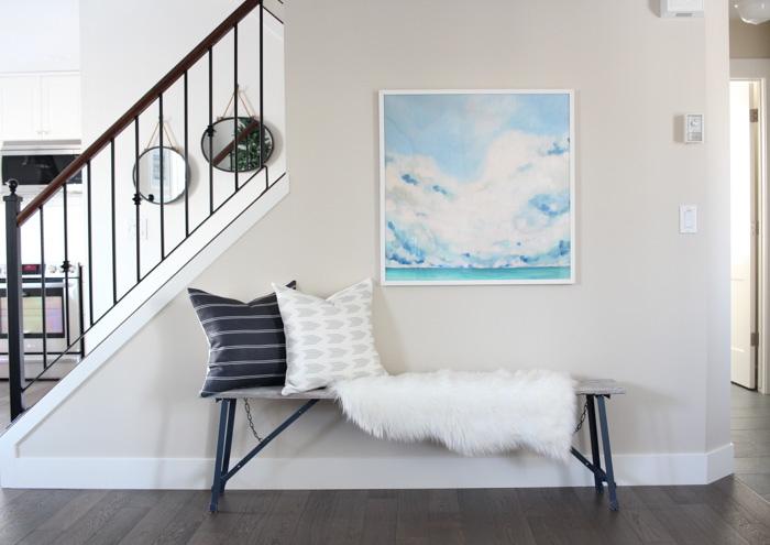 Using a Rustic Bench, Pillows and Art to Style an Entryway