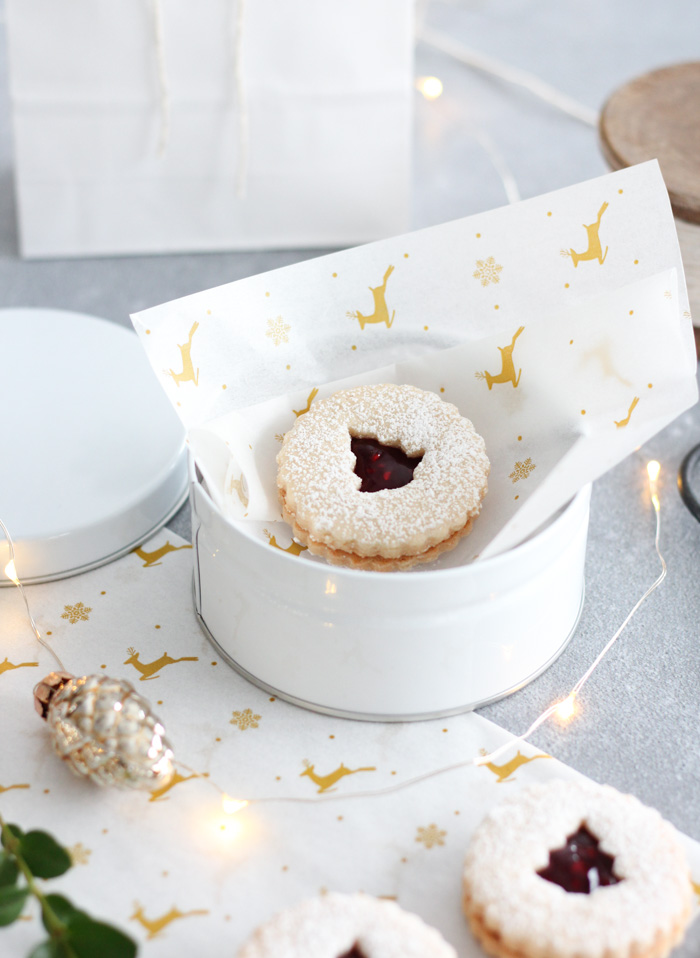 How to Wrap Baked Goods for Christmas - Christmas Linzer Cookies in White Tin with Reindeer Parchment Paper