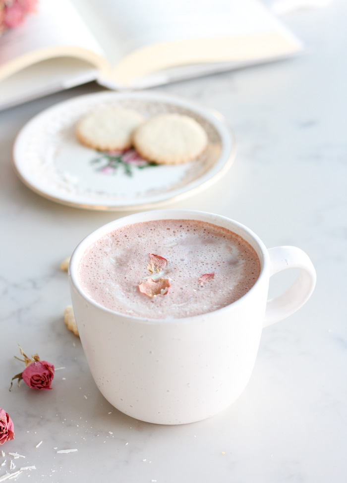 Homemade Pink Hot Chocolate for Valentine's Day in White Mug Topped with Dried Rose Petals