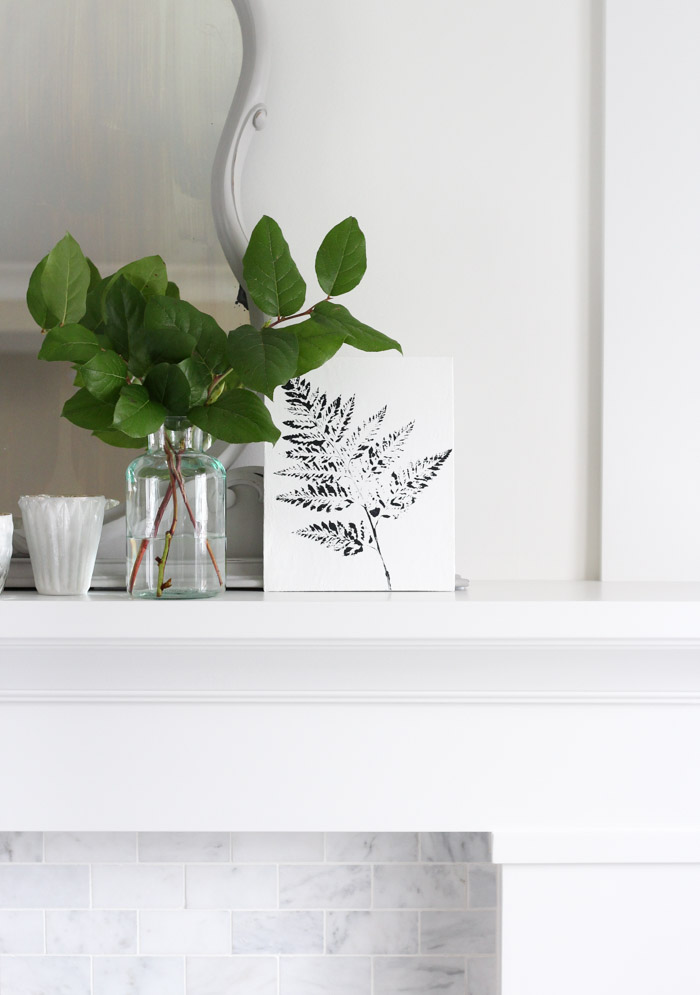 Black and White Printed Fern Art on White Fireplace Mantel