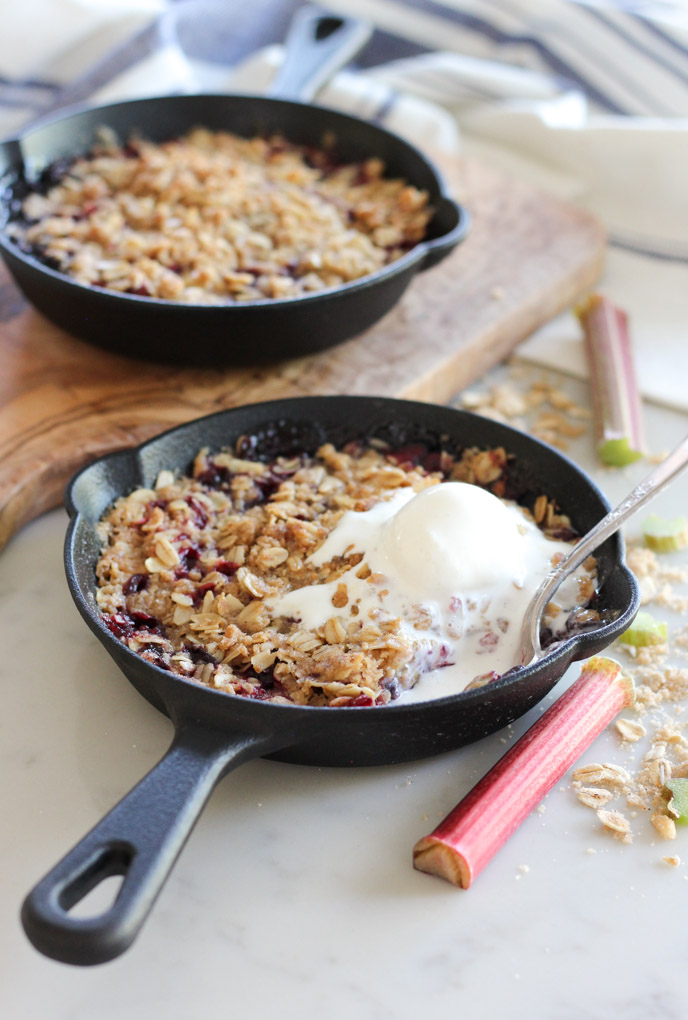 Cherry Rhubarb Crisp Baked in Mini Skillets and Topped with Vanilla Ice Cream