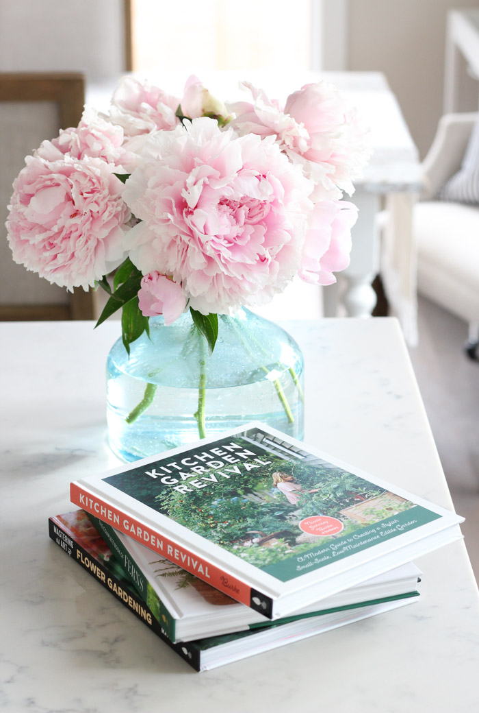 Gardening Books with Pink Peonies in Glass Vase