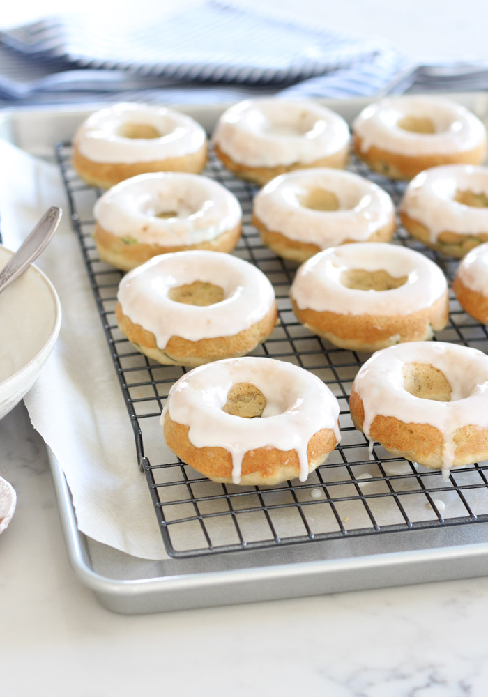 Baked Zucchini Donuts with Vanilla Glaze on Cooling Rack