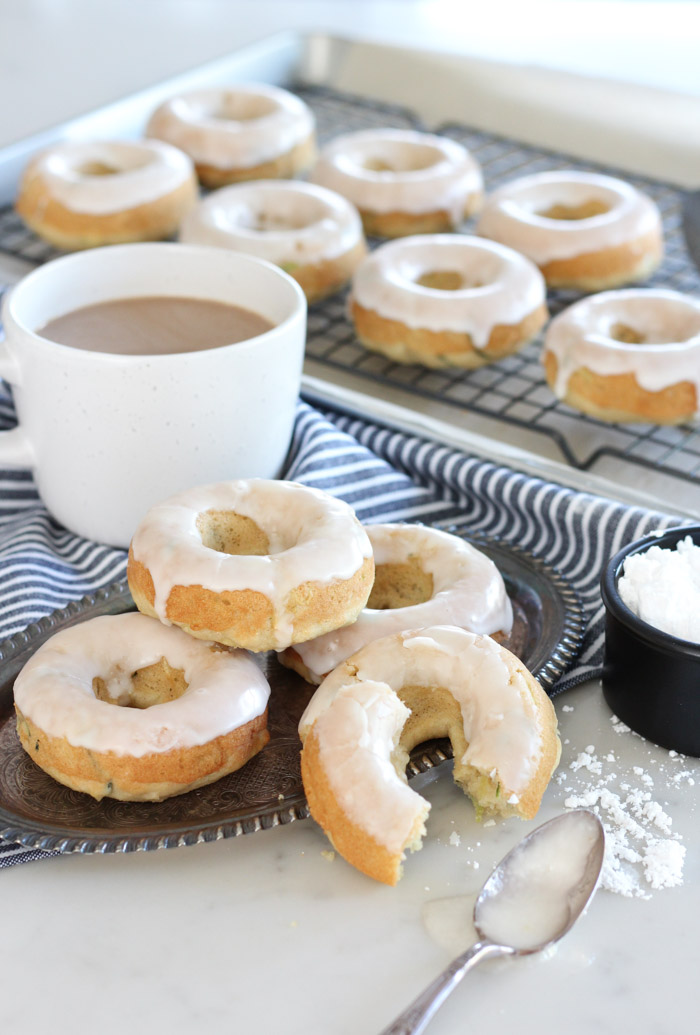 Baked Zucchini Donuts with Vanilla Glaze on Silver Tray with Cup of Coffee