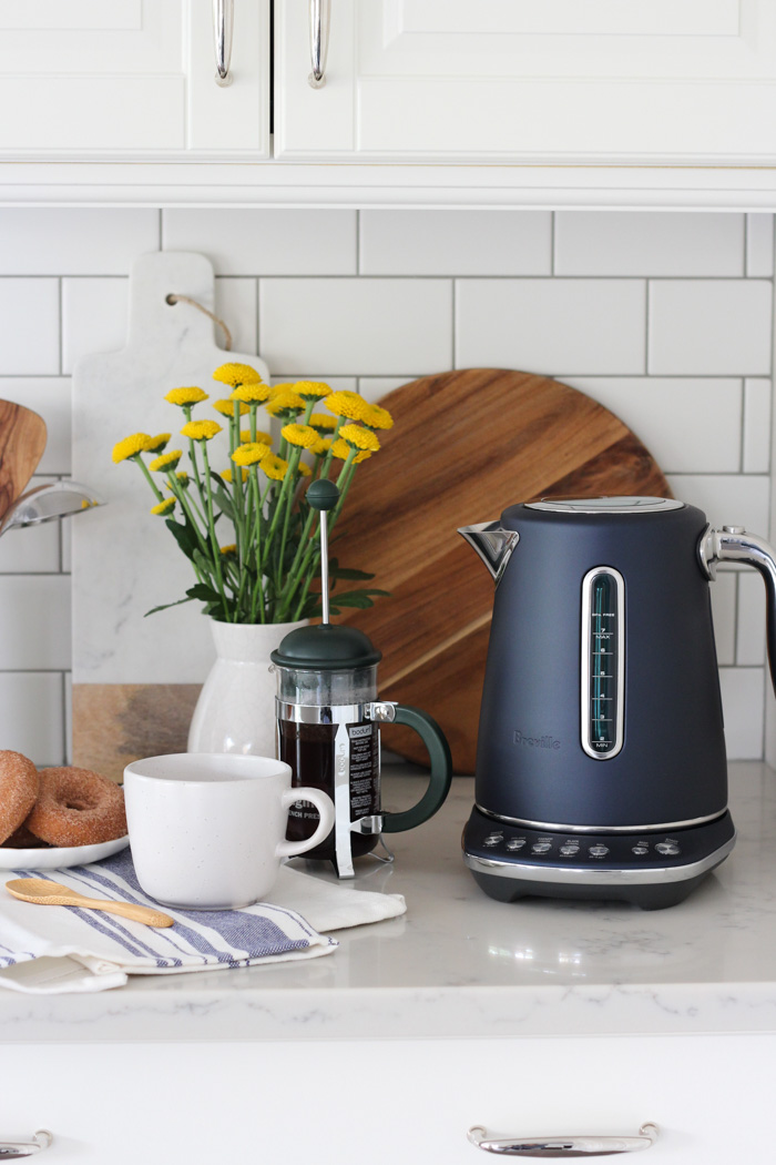 Breville Damson Blue Smart Kettle on White Kitchen Counter with French Press Coffee