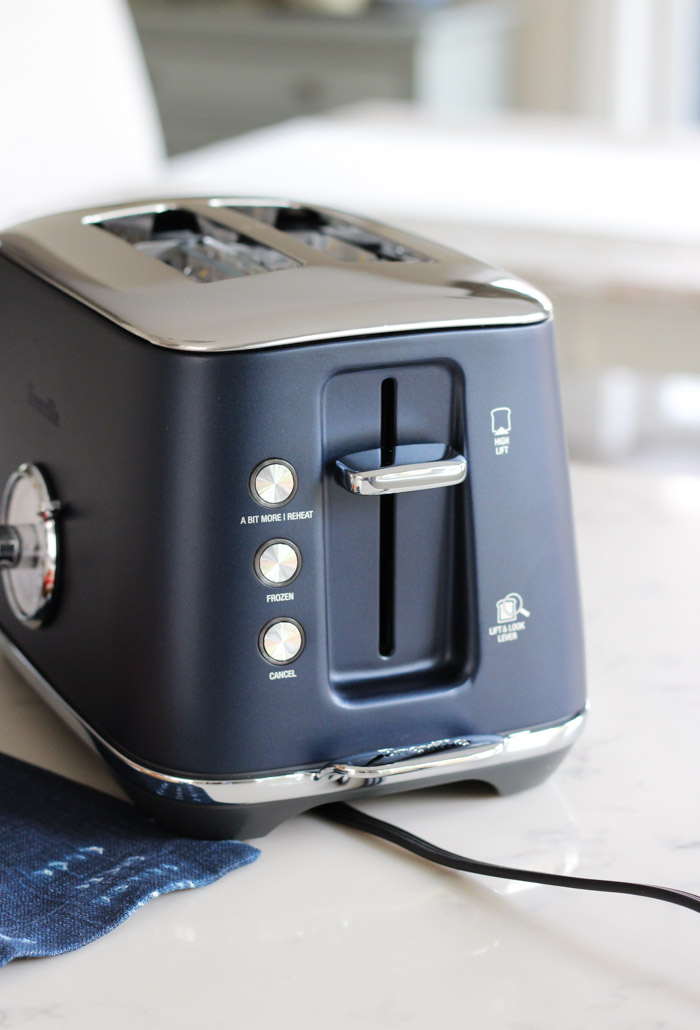 Breville 2-Slice Luxe Toaster in Damson Blue on White Countertop
