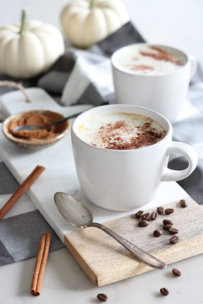 Pumpkin Spice Latte in White Mug on Marble Board