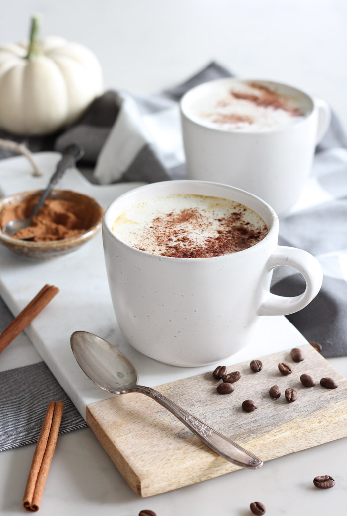 Creamy Latte in White Mug on Marble Board with Vintage Spoon