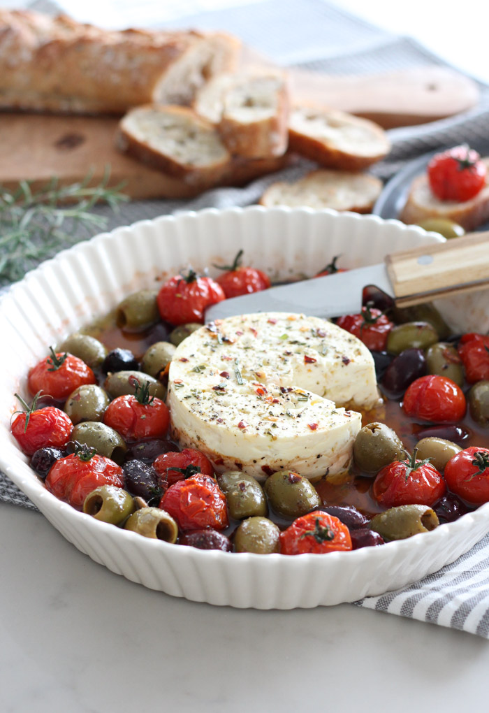 Baked Feta with Tomatoes and Olives in White Dish