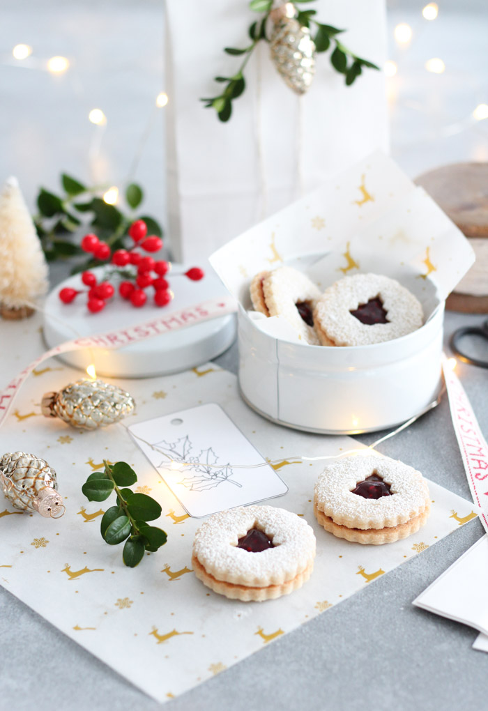 Christmas Linzer Cookies with Raspberry Jam and Powdered Sugar
