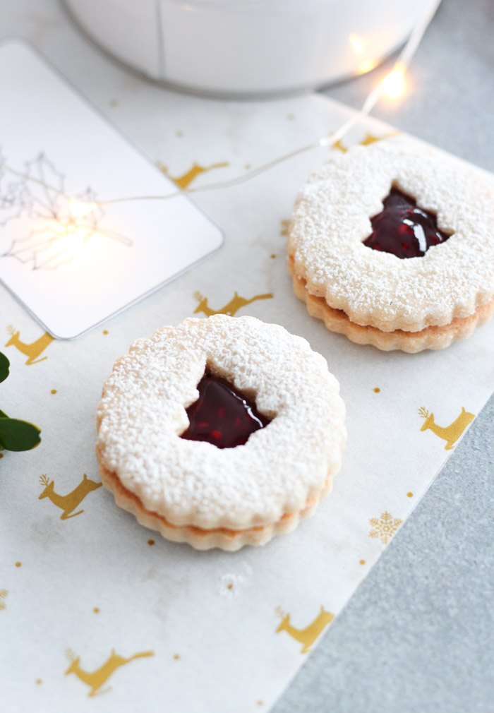 Christmas Tree Linzer Cookies Filed with Raspberry Jam and Sprinkled with Powdered Sugar