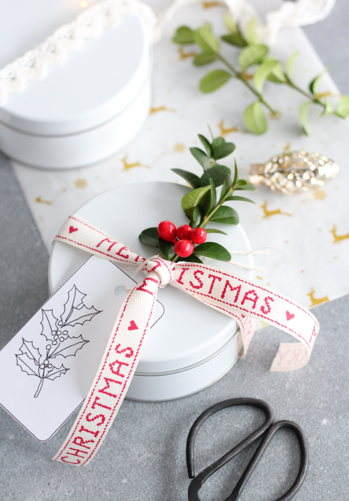 Holiday Cookies Wrapped in White Tin with Merry Christmas Ribbon and Greenery