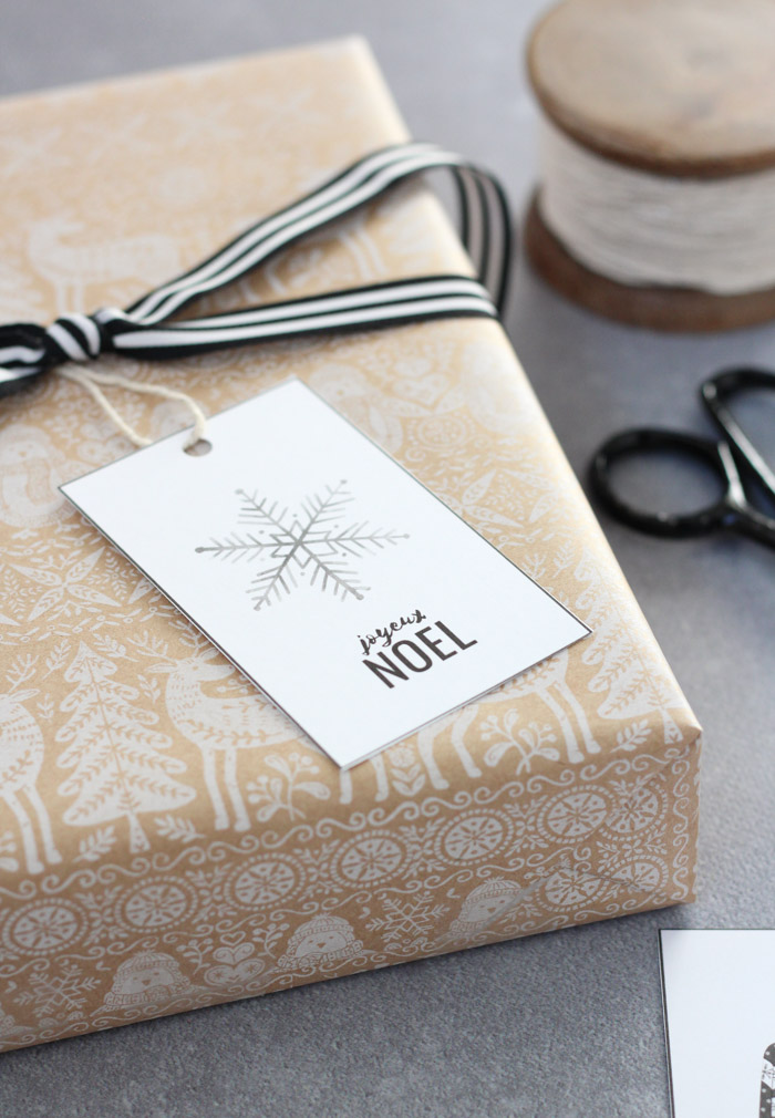Snowflake Gift Tag on Christmas Gift with Black and White Ribbon and Printed Craft Paper Wrap