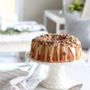 Holiday Bundt Cake with Caramel Pecan Icing on White Cake Plate