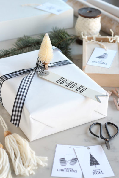 White Christmas Gift Wrap with Black Checkered Ribbon and Bottle Brush Tree