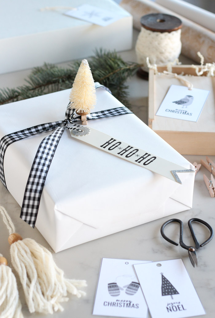 Simple Christmas Gift Wrap with White Wrapping Paper, Black Checkered Ribbon and Bottle Brush Tree