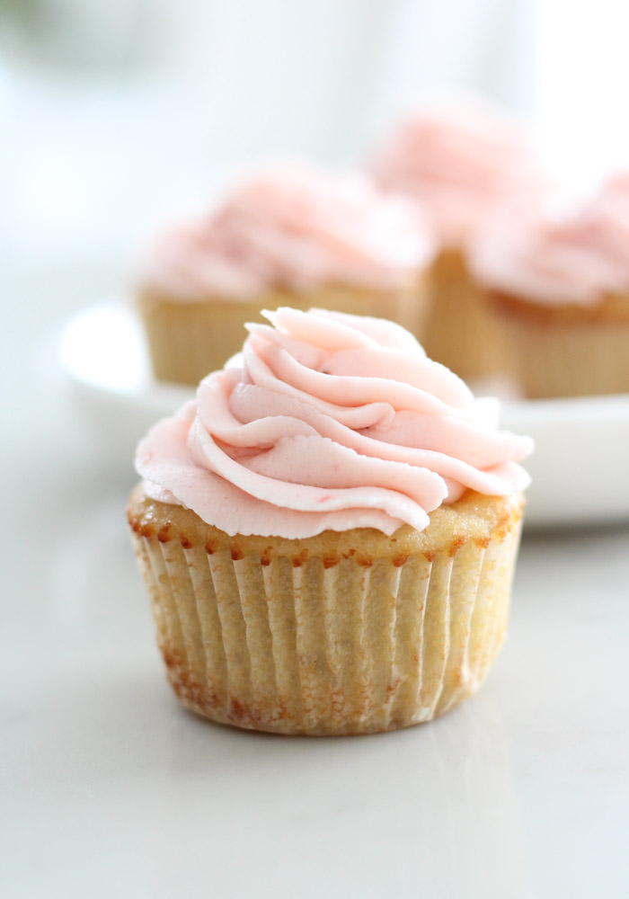 Almond Cupcakes with Fresh Strawberry Buttercream on Marble Plate