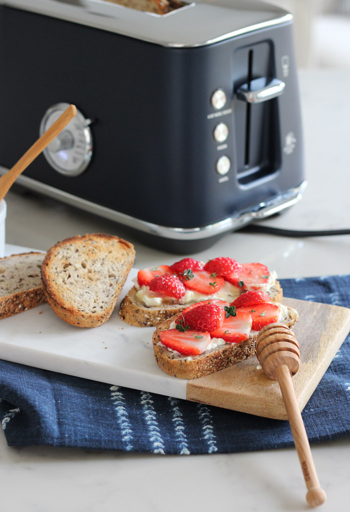 Strawberry Cream Cheese Toast with Honey and Lemon Thyme on Marble Serving Board