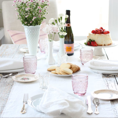 Pink Valentine's Day Table Setting with Flowers in Milk Glass Vases and White Table Runner