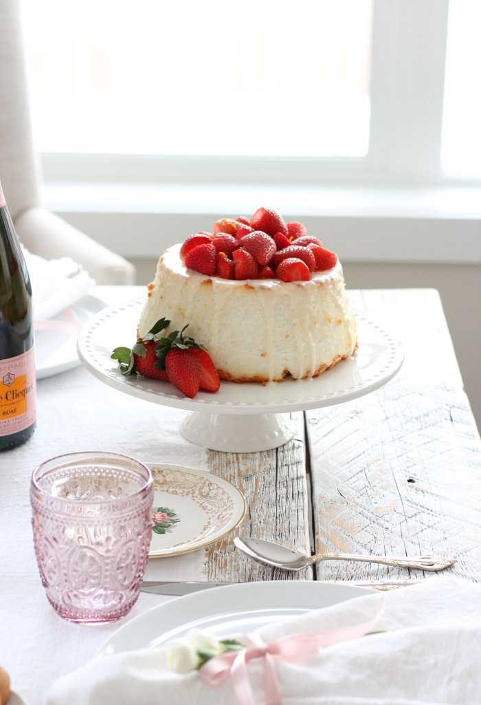 Valentine's Day Table with Strawberry Angel Food Cake on White Cake Stand