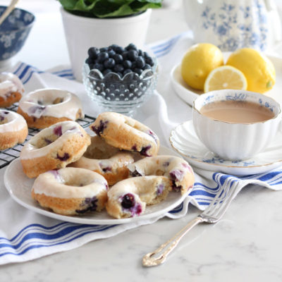 Baked Blueberry Donuts with Lemon Glaze on White Plate
